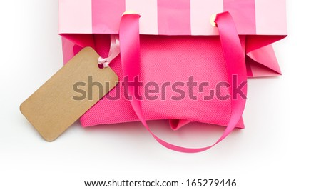 Pink gift bag with tag on a white background - stock photo