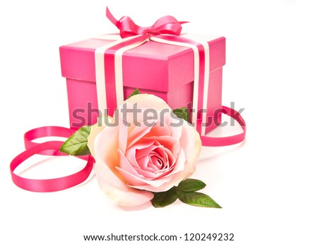 Pink gift box tied up with ribbons and a rose on white background