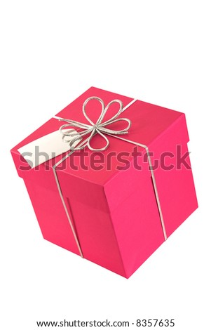 Pink gift box with a silver bow. A blank silver tag is included for the recipient's name. The image is isolated on a white background - stock photo