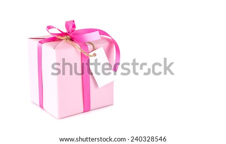 Pink gift box with blank tag on white background - stock photo