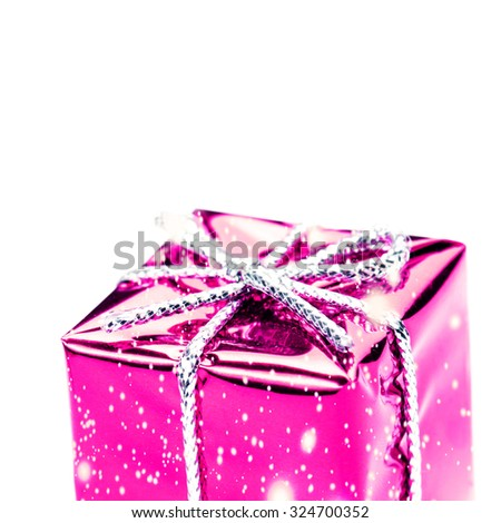 Pink gift box with silver ribbon, bow and snowflakes  isolated on white macro. Christmas, Valentine's, Birthday gift box - stock photo