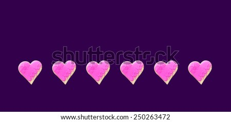 Pink  Gingerbread hearts Isolated on purple background - stock photo