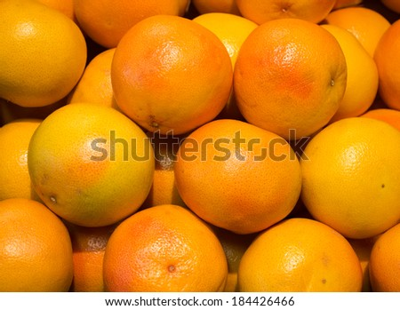 Pink Grapefruit on display at the Supermarket - stock photo