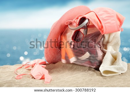pink hat summer bag and red sunglasses
