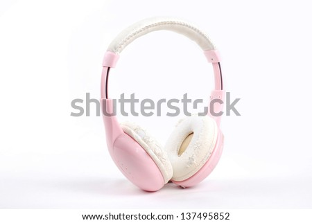 Pink headphone on isolate white background - stock photo
