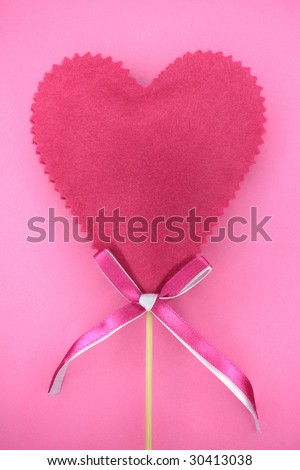 Pink heart on a pink background - stock photo