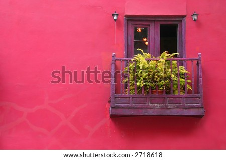 Pink house with purple balcony on Malaga, Spain