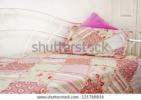 pink-ish patchwork quilt - stock photo