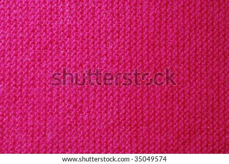 Pink knitted material background or texture close-up. - stock photo