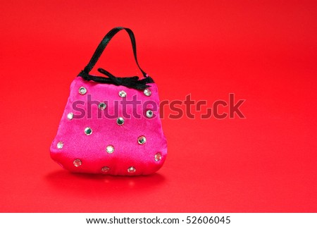 Pink Ladies Handbag on Red Background with Copy Space