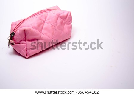 Pink lady's bag on a white background