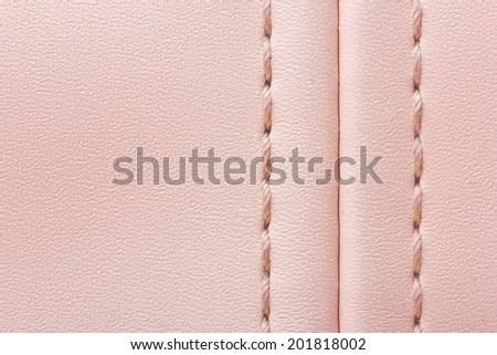 Pink leather woman bag closeup texture. - stock photo