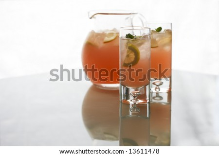 Pink Lemonade Two Glasses and Pitcher - stock photo