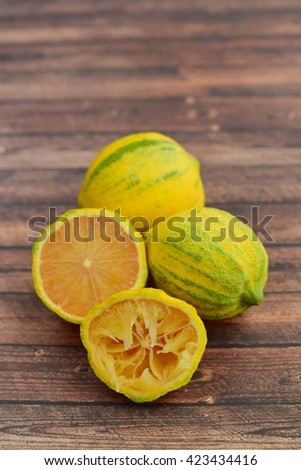 Pink lemons on wooden background