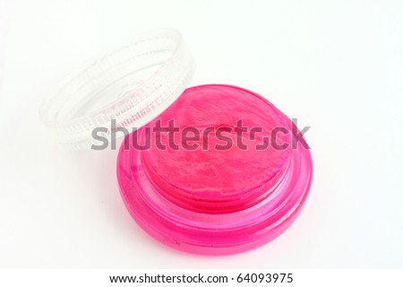Pink lip balm for your mouth in winter. On white paper.