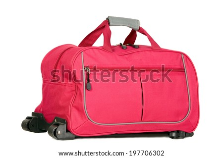Pink luggage with wheels for travel purposes - stock photo