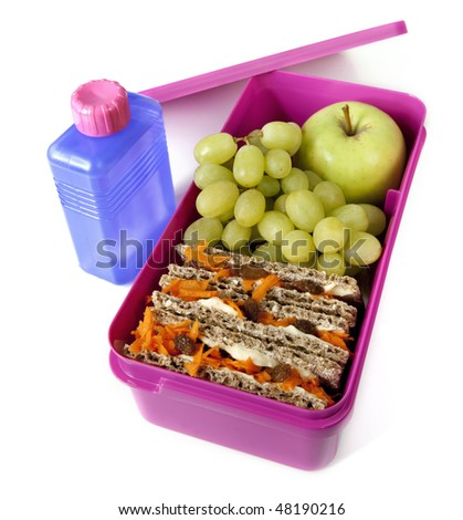 Pink lunch box packed with a healthy meal, and a bottle of water. - stock photo