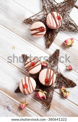 Pink macarons with chocolate and edible diamond - stock photo