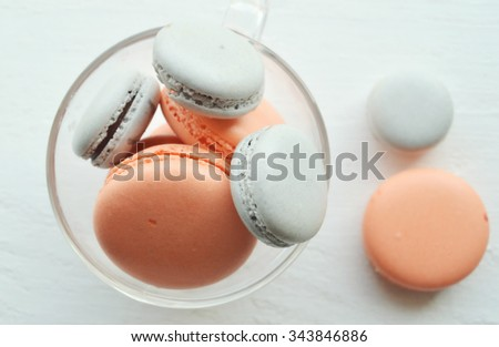 Pink macaroon with raspberry - stock photo
