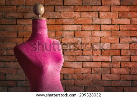 Pink mannequin with vintage wall - stock photo