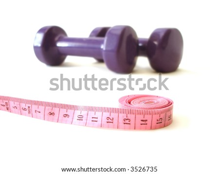 pink measuring tape and violet rubber dumbbell over white background - stock photo
