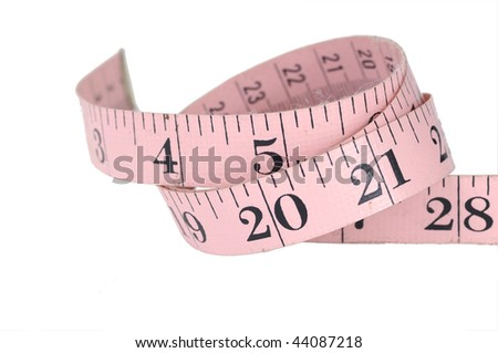 Pink measuring tape isolated over white - stock photo