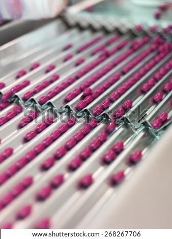 Pink Medical Pills in production Line