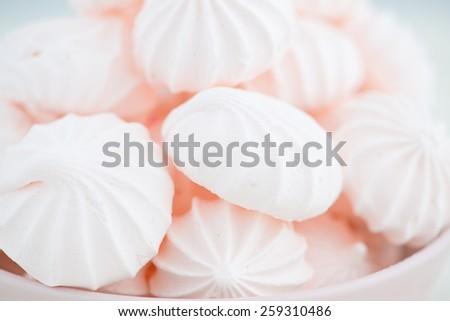 Pink meringue cookies. - stock photo