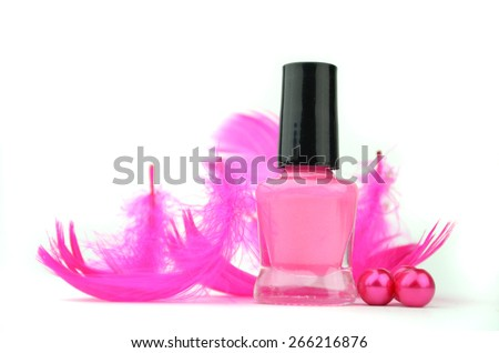 pink nail polish and feather - stock photo
