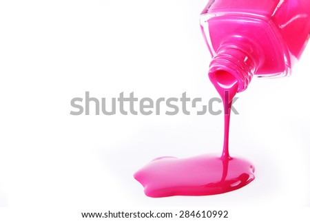 pink nail polish spilled on white background  - stock photo