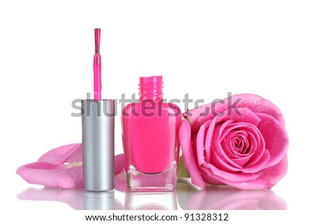 Pink nail polish with rose on white background - stock photo