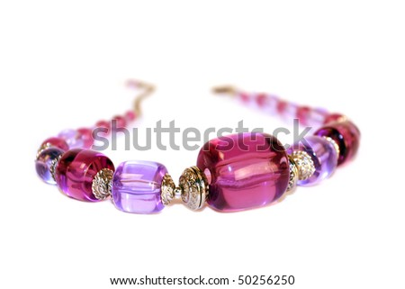 Pink necklace isolated on white background - stock photo
