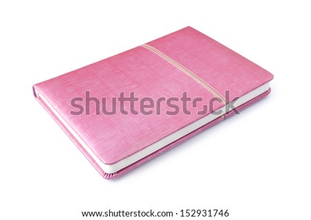 pink notebook on white background - stock photo