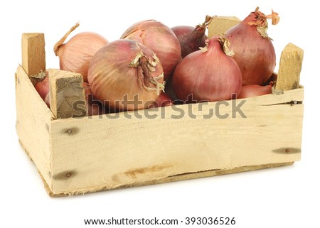 pink onions in a wooden crate on a white background - stock photo