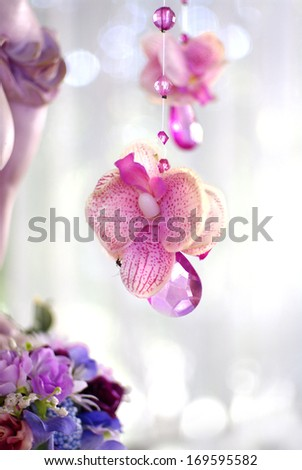 pink orchid flowers and beads curtain decorative for wedding - stock photo