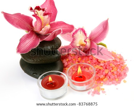 Pink orchids and candles
