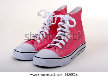pink pair of women's high top shoes - stock photo