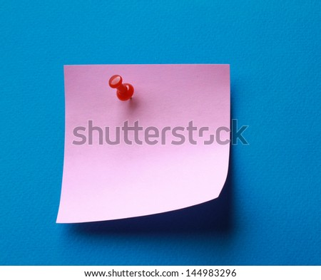 Pink paper note on blue background isolated. - stock photo