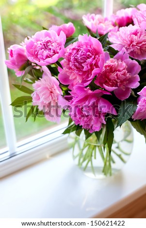 pink peonies on window sill - stock photo