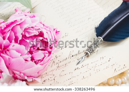 Pink peony flower with antique letter and feather pen - stock photo