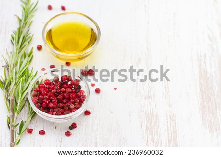 pink pepper with oil - stock photo