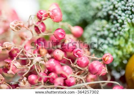 Pink peppercorns in macro - stock photo