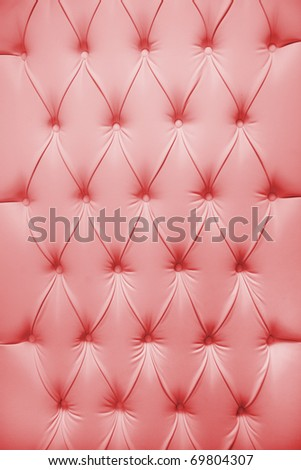 Pink picture of genuine leather upholstery - stock photo