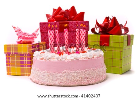 Pink pie with eight candles and gifts in boxes on a white background - stock photo
