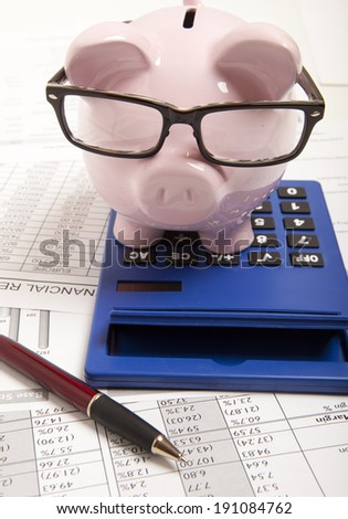 Pink piggy bank and calculator  - stock photo