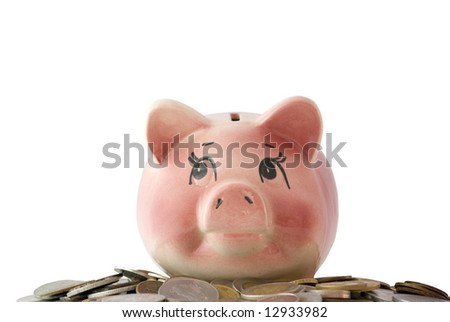 Pink piggy bank  isolated on white background with coins - stock photo