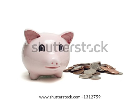 Pink piggy bank isolated on white with pile of coins beside it
