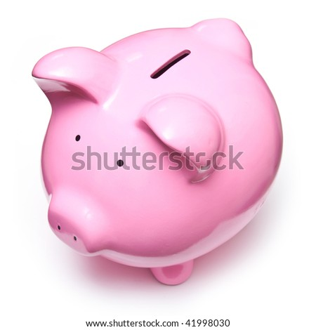 Pink piggy bank money box isolated on a white studio background.