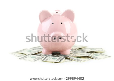 Pink piggy bank on dollars isolated on a white - stock photo
