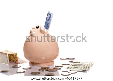 Pink Piggy Bank on isolated on white background with coins - stock photo